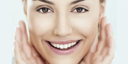 Woman with flawless skin at Bella Reina Spa