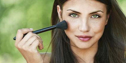applying makeup for a natural look at Bella Reina Spa