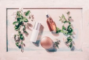 Skincare Products, Cermide serum, moisturizer, on light pink background